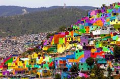Mexican Artists Transform Neighbourhood Into One Giant, Mind-Blowing Mural. Photograph by Sofia Jaramillo/AP
