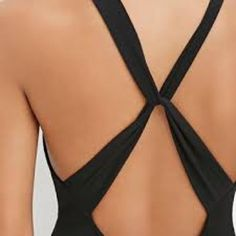 Twisted Back Black Tanktop Great for summer! This looks great with shorts or skirts. Very soft, twisted back detail. The front is also adjustable as it slides on the fabric that makes the twist. Has fitted bottom hem. Hand wash. From smoke free home. Tops Tank Tops