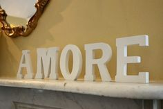 Pre-painted white letters purchased on sale from Michael's,  then sprayed gold and used a second time on the mantelpiece at the wedding venue!