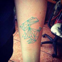 Tatuaje de conejo geometrico