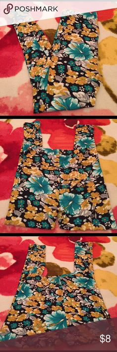 Tropical hibiscus floral print leggings These are just like the hot kiss leggings, but some other brand. Really soft. Teal and gold or mustard yellow with black and white. Looks like hibiscus flowers. Worn 2 or 3x. Pants Leggings