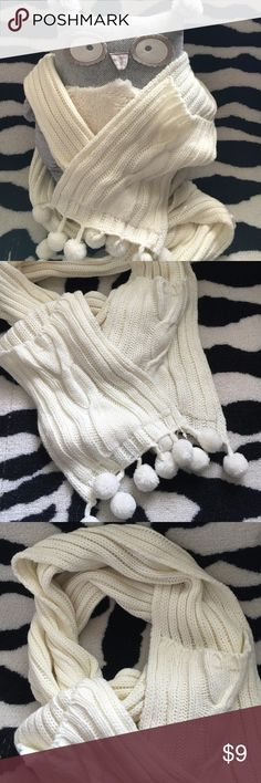 Cozy wrap Pom Pom scarf with hand pockets Very warm and cozy wrap knitted scarf with hand pockets build into the ends. Also has cute Pom Pom details at the bottom. Express Accessories Scarves & Wraps