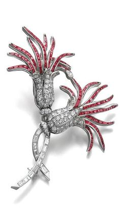 Ruby and diamond brooch, 1950s Designed as a pair of thistles set with calibré-cut rubies and circular-, single-cut, baguette and a pear-shaped diamond, French assay and partial maker's marks, a few small stones deficient.