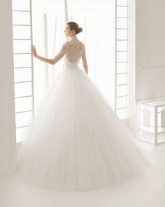 DOSEL vestido de novia con blusa de malla con body de punto y  falda  de  tul  con cinturon  de raso algodon.