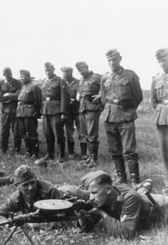 German soldiers test shooting with soviet DP-27.