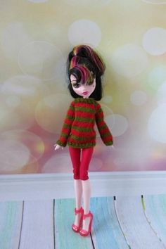 Monster High doll clothes. Hand-knitted red green sweater in | Etsy Monster High Boys, Monster High Doll Clothes, Monster High Custom, Girl Dolls, Barbie Dolls, Green Sweater, Custom Dolls, Green Stripes, Red Green