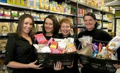 Here are the owners & staff of Wray Organic Toowoomba showing off some awesome produce with Deborah Wray herself!