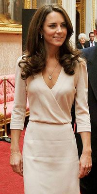 Kate Middleton Style File: July 2011  A svelte Kate Middleton attends the unveiling of her wedding dress at Buckingham Palace on 22 July 2011, wearing an understated wrap-over cream frock