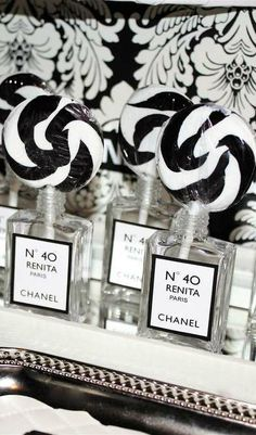 Lollipop favors at a Coco Chanel birthday party!  See more party planning ideas at CatchMyParty.com!