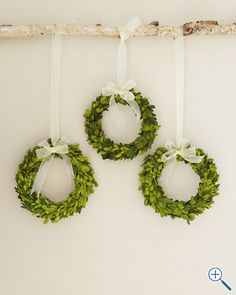 Hang small, simple wreaths from a piece of driftwood or branch.