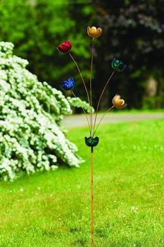 Add a punch of elegant color to your garden or yard with our Multicolor Lily Cup Chimes Garden Stake. This piece features lilies in brilliant blues, reds, greens and golds. This jewel-toned piece, which also functions as a staked wind chime, will instantly elevate any outdoor space. #GardenStakes #Gardenstake #gardenstake #gardenstakes #gardening #gardenlover #gardenart Garden | Gardening | Garden Art | Garden Decor | Garden Stake Diy Garden Decor, Garden Art, Garden Design, Garden Ideas, Glass Garden, Dream Garden, Lawn Ornaments, Garden Ornaments, Metal Yard Art