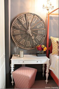 Big rustic clock over the side table...never would've thought if that