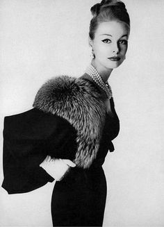 1958 Monique Chevalier in sheer black wool suit, the jacket trimmed in Canadian silver fox by Hannah Troy, photo by Irving Penn, Vogue