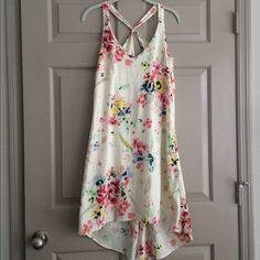 H&M Floral Asymmetrical Racerback Dress Beautiful, light dress for spring/summer. V front, racerback with keyhole in back. Slight high-low dimension to skirt. Silky material. H&M size 4, fits a regular size small. Worn once, in like-new condition! H&M Dresses High Low