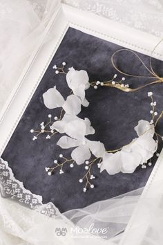 http://www.moalove.pl/en/hair-adornments/product/68/serenity-silk-blossoms-and-crystal-hair-wine/
