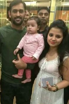 MS Dhoni with his wife & daughter