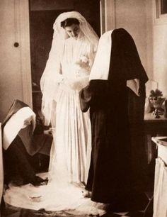 Bride of Christ - wearing a bridal gown as she takes her vows.