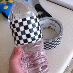 Use Decorative Duct Tape to spruce up bottled water.     You can even leave the bottles in a tub/cooler of ice, and the tape stays on!