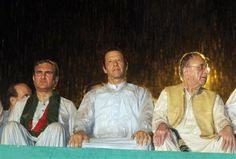 Pakistan's cricketer-turned-politician Imran Khan, center, with other his party leaders attend an anti government rally during heavy rain in Islamabad, Pakistan, on Saturday. (Photo: AP)