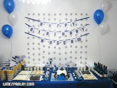 Real Madrid themed party    Love the soccer ball garland on the wall  Popcorn buckets with flags