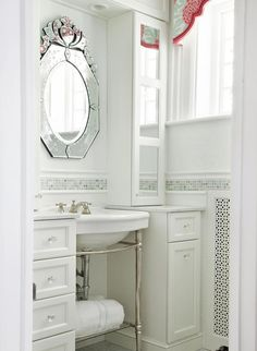 Half-Bath Hacks: Natural light and white walls brighten the space >> http://www.diynetwork.com/bathroom/17-clever-ideas-for-small-baths/pictures/page-6.html?soc=pinterest