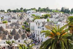 """Nestled in the geographical heel of Italy, the picturesque village of Alberobello is home to mouthwatering peasant cuisine, the """"kindest people in all of Italy,"""" and white-washed limestone dwellings famous around the world for their cone-shaped roofs."""
