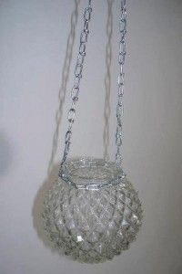 Sue Gerdes has a method of taking any glass globe, new or used, and turning it int a hanging solar 'fairy light.'