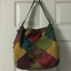 Fossil hobo purse. Suede and leather patchwork hobo purse. Great condition. Clean inside. Nice size bag. Fossil Bags Hobos