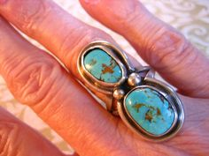 My grandparents gave me one just ike this on a summer vacation and I still have it and love it.  When we took our daughters to the Grand Canyon last year, I bought them each a ring.  Vintage Sterling Silver Southwestern Turquoise by charmingellie, $68.00
