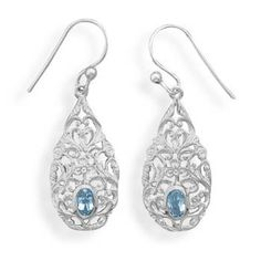 Shiny ornate swirls of sterling silver encase a sparkly oval blue topaz in these sterling silver french wire earrings. Blue topaz is 5 x 3.5 mm. #silver #blue #topaz #earrings #jewelry