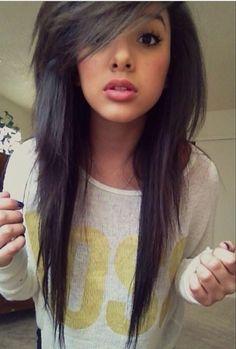 I love her hair cut . Side swept bangs long hair but short top layers