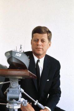 John F. Kennedy with a model of PT 109 by Elliott Erwitt