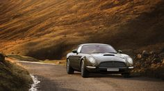 No doubt the image of a dapper 007 winding his way through the Alps will be at the forefront of your mind already, but despite the looks, this is not a phoney Aston Martin bursting with Botox; it's the fresh faced Speedback GT from David Brown Automotive. Aston Martin Db5, Automobile, Classic Corvette, Automotive Manufacturers, Gt Cars, Cars Uk, David, Digital Trends, Chevrolet Corvette