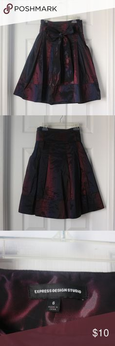 Black-Burgundy Express Design Studio skirt Made of a unique material that is 100% polyester. An iridescent, rain-wear feel on the outside and repels water. Fully lined, lining is soft against your skin. Side zipper and tied belt at waist. Mannequin shots show the color most accurately. Express Skirts A-Line or Full