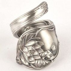 This was what my Mom and Dads wedding rings were like! Made from silverware!