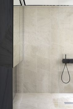 Tristan Auer angled shower tiles | stone and black