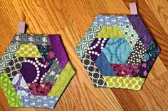 A Quilter's Table - log cabin hexi potholders, pattern by SewCanShe