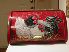 vintage bread box... hand painted. I have a blue wooden roll top with chicks painted on it!