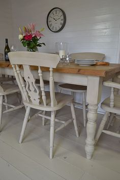 Large dining tables with turned legs and a solid wood tabletop are a key piece of furniture in creating the farmhouse feel in a large open-plan kitchen. This set has been painted to match, and lightly distressed to give a rustic country cottage feel. http://www.rusticevents.com