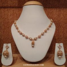 Gold pearl mala necklace set with jhumka earrings. For inquiries please contact NAJ Pearl Necklace Designs, Gold Earrings Designs, Gold Jewellery Design, Necklace Set, Gold Designs, Gold Necklace, Circle Necklace, Diamond Jewellery, Designer Jewelry