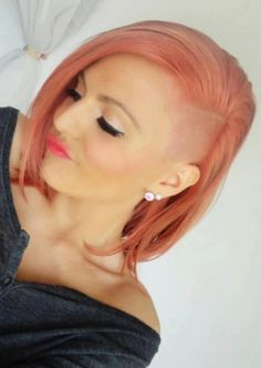 half-shaved and side swept hairstyle with soft pink coloring