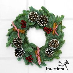 Don't forget Christmas decorations for outside of the house. Interflora's Christmas wreath is a great classic choice,