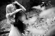Couple embraces on their wedding day at the Caldwell Lily Pond.