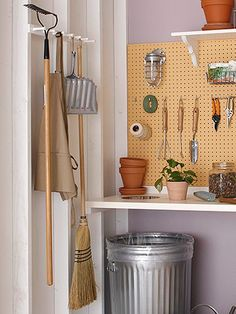 Use a coat rack to store garden tools  Some garage storage systems look hard and masculine, but a repurposed coat rack ($12.99) keeps this gardening station organized while giving the space a feminine look.  Seven peg wooden coat rack: SpaceSavers; spacesavers.com