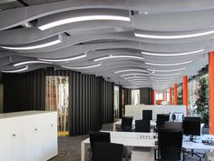 Great lighting and ceiling treatment that could mimic the shape  of the Ascena wave logo.  Skype Corporate Headquarters by WAM