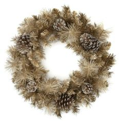 Z Gallerie: Glamorous glittery pine wreath constructed of pine branches and pine cones, bathed in a coat of shimmering champagne glitter