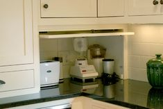 no clutter in the kitchen- hidden small appliances with outlet, just pull out and use when needed