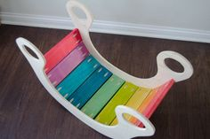 Make this adorable rainbow rocker yourself for less.