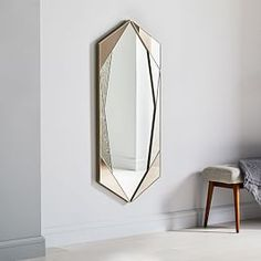 Reflect on old Hollywood glam with this faceted wall mirror, dressed up in a mix of foxed and tinted finishes. x x Metal frame in an Antique Brass finish. Mirrored glass in foxed and tinted finishes. Mirror Wall Art, Mirror Tiles, Floor Mirror, West Elm, Anthropologie, Tinted Mirror, Room Planning, Bedding Shop, Mid Century Design