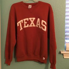 TEXAS sweatshirt TEXAS sweatshirt. Worn only a few times. Last name written on the tag but it's mostly faded off. Russel athletic Tops Sweatshirts & Hoodies